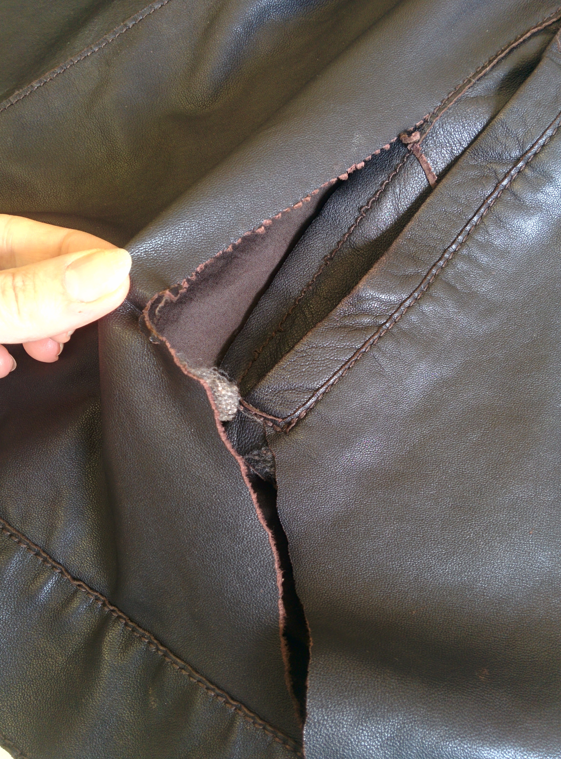 Before - tear in the leather and pocket